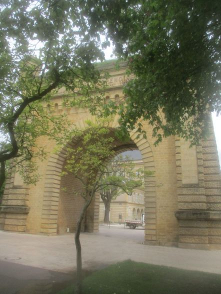 An arty attempt with the big gate and the trees.