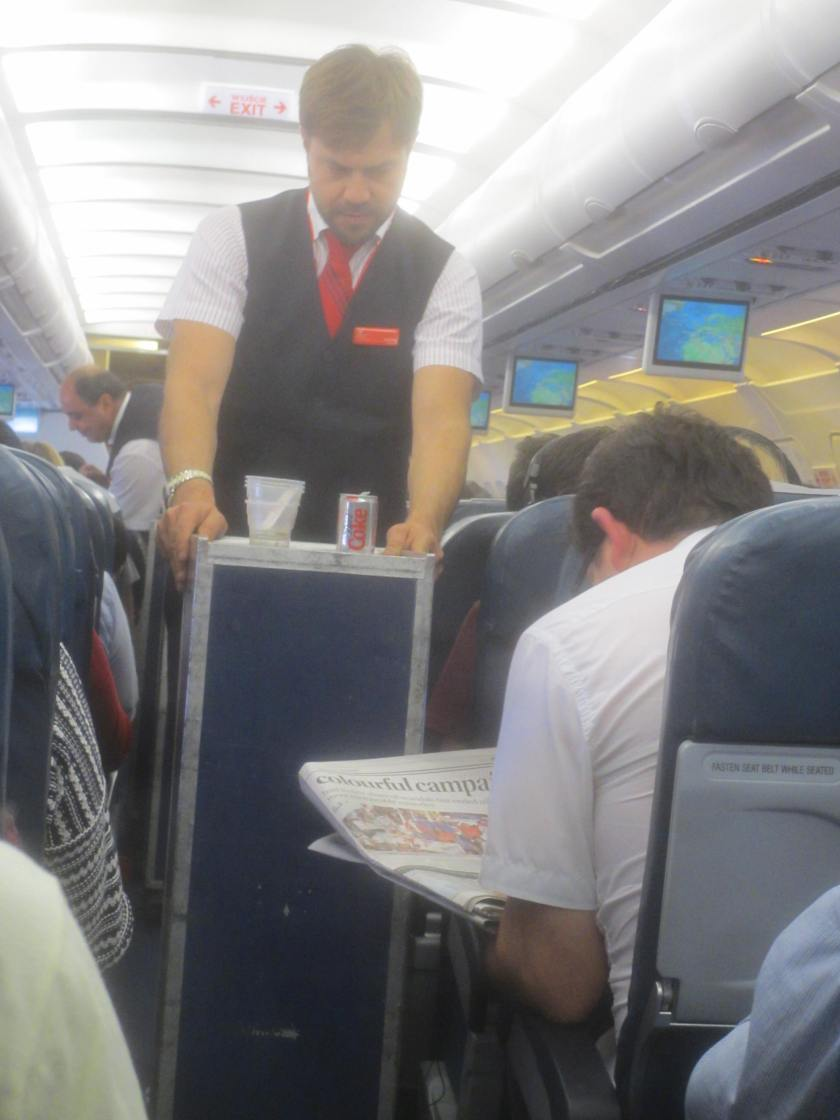 Meal service on Air Malta flight.